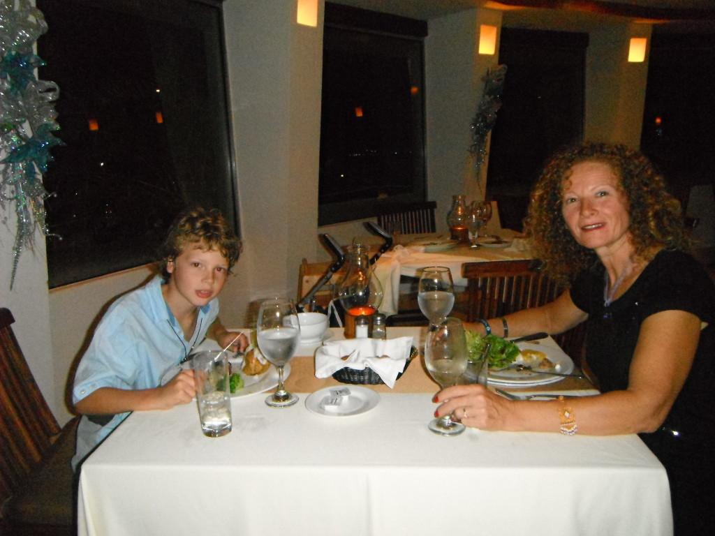 Exploramum and Explorason - Sea Adventure Resort & Waterpark Cancun Mexico - enjoying dinner